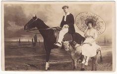 Art nouveau couple on stuffed horse and donkey. Belgian photograph. 1910's.