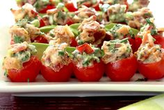 Easy BLT mini-bites made with cherry tomatoes and classic BLT stuffing. They're small and delicious...but always a big hit at parties. Paleo appetizer recipe!