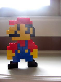 Lego Mario! I am so making this in a few minutes (I Love Legos & Mario) not to mention the legos are already all over the floor.
