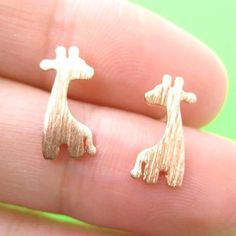 A pair of animal themed earrings made in the shape of giraffes in copper! They are made with allergy free titanium earring posts and backs. For more giraffe jewelry and these giraffe earrings in other