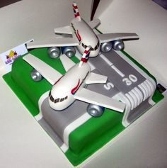"""On the Runway"" The perfect cake for the airport/aircraft enthusiast! Square cake featuring a runway design with very subtle personalisation using the runway markings for the recipients age and initials. The two aeroplanes have been completely handcrafted from modelling paste then hand painted and are 100% edible!"