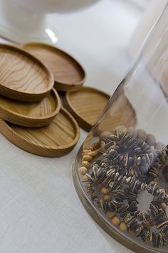 simple decorating beads in a glass - also love these wooden coasters