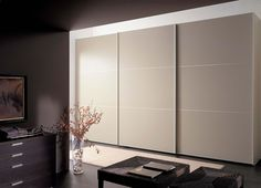 modern and fancy bedroom wardrobes and closets stylish armoires italian beige wardrobe design inspiration with three sliding doors in contemporary bedroom