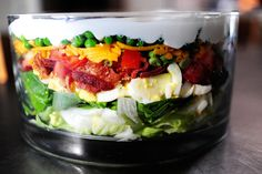 Fresh and delicious 7-Layer Salad from the Pioneer Woman. Definite pot-luck hit!