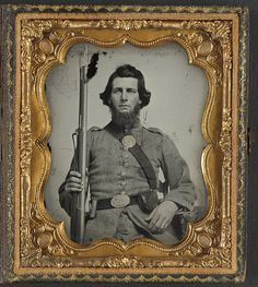 [Unidentified soldier in Confederate uniform and Georgia state seal belt buckle with musket] (LOC)