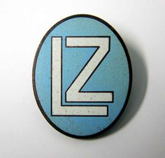 "This is one (there were several), of the pre-1936 Zeppelin Officers Cap Badges, which of course was worn during the Nazi (NSDAP) period but before the badge was changed to the Eagle and swastica badge. It is taken from an original and has appropriate markings on the rear and is made in the correct metals and enamel.  'LZ' stands for Luftschiff Zeppelin, or ""Airship Zeppelin"". This badge has been seen on crew pictures from the early 1930's to approx 1935.  www.warhats.com"