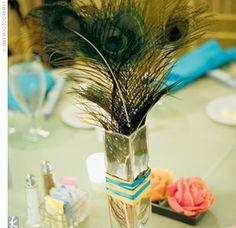 Peacock feathers as centerpiece. These would look really cool randomly stuck in flower arrangements.