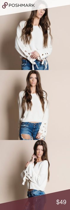 "Lace Up Sleeve Sweater Top Sweater top with grommet lace up sleeves. This is an ACTUAL PIC of the item - all photography done personally by me. Model is 5'10"", 33""-24""-36"" 32C wearing the size small. NO TRADES DO NOT BOTHER ASKING. PRICE FIRM. Bare Anthology Sweaters Crew & Scoop Necks"