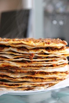 Lahmacun. Traditional Turkish/Middle Eastern Lahmacun. A thin crust topped with a meat/vegetable mixture.