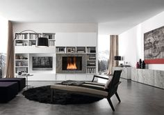 Modern media room with a grey-based décor and a fireplace built-into the wall unit