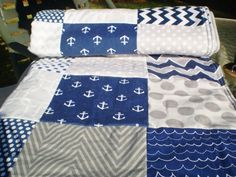 Nautical Baby quilt,navy,grey,Baby boy bedding,baby girl quilt,Patchwork Crib quilt,chevron baby blanket,dot,waves,newborn,fleece,Out to Sea by happyquilts on Etsy https://www.etsy.com/listing/211159453/nautical-baby-quiltnavygreybaby-boy