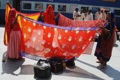 Home Everywhere Photo by Shivji Joshi -- National Geographic Your Shot  Women while waiting train drying their wet sarees on Railway Platform at Jodhpur