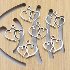 Would make very inexpensive and cute earrings, necklace pendants, or bracelet charms! Cute Earrings, Vintage Jewellery, Antique Silver, Diy, Pendants, Charmed, Pendant Necklace, Antiques, Heart