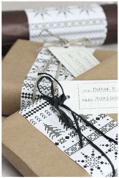 Like this idea of brown parcel paper with an accent 'runner' of patterned wrap