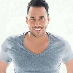 Romeo Santos.. That boy can sing & he looks good!