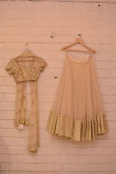 Beige tulle light lehenga with big gold border and sequin blouse