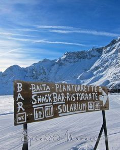 A rustic sign leading to lunch, Cervinia Italy. SPLENDID MARKET: Cervinia, Italy...
