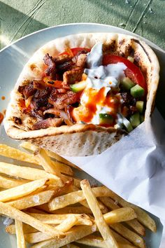 NYT Cooking: This lemon-bright and paprika-dusted pita filling is based on memories of the gyros served at Kalimera Souvlaki Art in Melbourne, Australia, one of the best Greek restaurants in a city that supports a great number of them. Greek Recipes, Pork Recipes, Cooking Recipes, Cooking Pork, Cooking Turkey, Sandwiches, Gyro Recipe, Shawarma Recipe, Tasty
