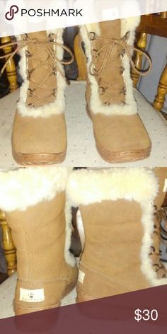 NEW BEARPAW DARK TAN WOMANS BOOTS SIZE 7 New BEARPAW dark tan suede boots size 7. Never worn. See listing for other colors. BearPaw Shoes Lace Up Boots