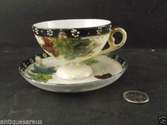 HAND PAINTED NIPPON FOOTED TEA CUP AND SAUCER GOLD AND GREENS