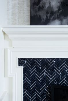 Dark chevron tile on this fireplace design | The Curated House