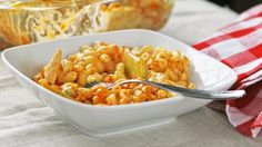 Blogger Sarah W. Caron from Sarah's Cucina Bella combines creamy mac and cheese with spicy Buffalo chicken in this delicious comfort food dish.