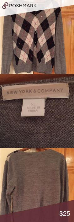 New York & Co Button-Down Argyle Sweater XL New York & Company Argyle Sweater, Size is XL. The. Colors are Gray, White & Black & Red. This button down sweater is perfect for the fall, spring and winter seasons. New York & Company Sweaters