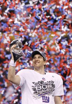MVP Eli Manning holds the Lombardi trophy at Super Bowl XLVI