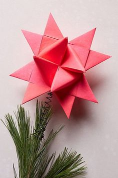 Small-Space Decorating That Doesn't Feel Cluttered #refinery29  http://www.refinery29.com/small-space-holiday-decorating#slide-22  Pink has always been the real star of the show. Anthropologie Origami Star Tree Topper, $18, available at Anthropologie....