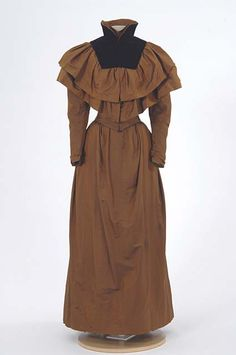 1890s brown changeable taffeta dress with matching cape. Worn by Mrs. Edward A. Everett after her wedding for travel to her honeymoon. Made by dressmaker, Miss Lizzie Morrissey, Minneapolis, Minnesota.