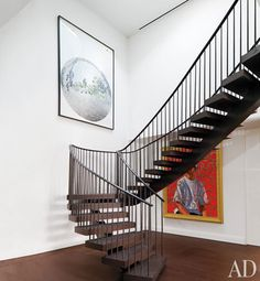 Floating staircase crowned by a circular skylight; artwork at left is by Dave Muller.