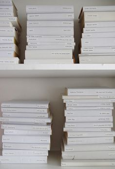 Books covered in plain white paper with titles printed. If your books are not so pretty this always works for me.