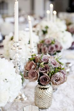#centerpiece Event Planning by fabyoulousevents.com/ Floral Design by Just-Bloomed.com Photography by photogen-inc.com  Read more - http://www.stylemepretty.com/2011/07/06/minneapolis-wedding-by-photogen-inc-just-bloomed/
