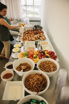 photograph by Justin Hackworth. Breakfast buffet. Bagels, croissants, butter, flavored cream cheese, yogurt, toppings, fruit, milk, juice
