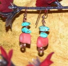 Pretty nuggets of blue turquoise, tiny copper beads and chunks of beautiful salmon-colored reef coral are presented on these Susen Foster earrings with copper artwork. This pair of earrings will make any day a brighter one.