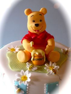 This adorable Winnie the Pooh Cake was created for a christening.