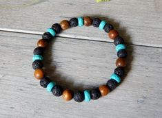 About the Bracelet A mens casual beaded bracelet with all the right colors. Turquoise, wood and lava make a great combination. Bracelet Details: This beaded mens bracelet is made with: ★ 8mm Volcano R