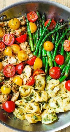 Pesto Chicken Tortellini and Veggies – healthy, easy Mediterranean-style dinner. Sliced boneless, skinless chicken thighs are cooked with sun-dried tomatoes in olive oil. Then, cooked chicken is combined with asparagus, cherry tomatoes, tortellini, and basil pesto! #pesto #chicken #pestochicken #veggies #vegetables