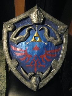 Hylian Shield cosplay prop finished by Spaith Marvel Dc, Dc Comics, Link Cosplay, Shigeru Miyamoto, Paper Engineering, Japanese Games, Cosplay Tutorial, My Pokemon, High Fantasy