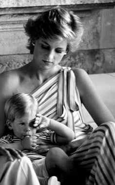 Diana Princess of WalesPrincess Diana sits with a very tired Prince Harry while on vacation.
