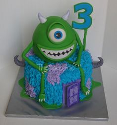 Monster's Inc Cake. Vanilla cake with caramel cream filling. Mike is made from krispies. All edible!