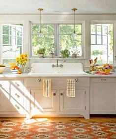 I love the windows and light coming in. The sink is great! 6 tips to add farmhouse style to your home.