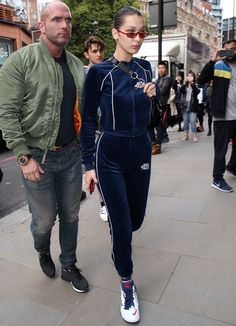 Bella Hadid Attends London Fashion Week Wearing Visitor On Earth Sweatsuit With Kith X Nike Sneakers