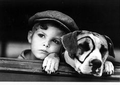 Original photograph of Dickie Moore from the Our Gang shorts with Petey the dog. In other photographs, an elephant has been photo shopped into the original picture.