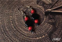 This black and red bead ear piece is a must have for every woman.... It suits all attire at all times for all ocassions