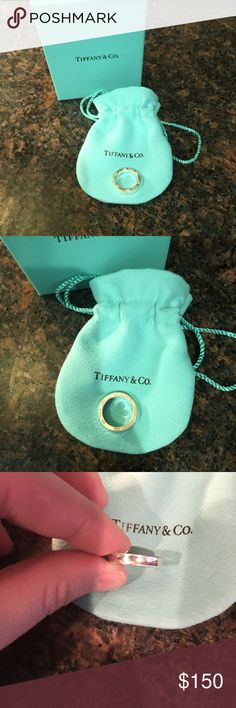 Tiffany & co. Ring Authentic Tiffany & co. ring. Size 4.5. Plain and simple band with the logo on the side. Bag and box included. 🚫- No trades 🚭- Listings from a non-smoking home 📬- Fast shipping! 💌- Feel free to make an offer 💯- items as described, feel free to ask questions 🔎- Search my closet for other great listings 🛍- Happy Shopping!! Tiffany & Co. Jewelry Rings