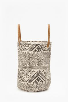 <ul> <li> Woven cotton laundry basket with contrast faux-leather handles</li> <li> <strong>Diameter:</strong>45cm <strong>Height:</strong>65cm</li> </ul>