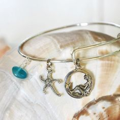 Expandable Alex and Ani type bracelet with Mermaid, Dancing Starfish and Seaglass by SeaglassI on Etsy https://www.etsy.com/listing/195264710/expandable-alex-and-ani-type-bracelet