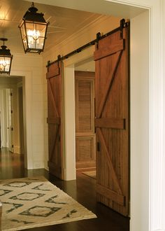 Sheppard Construction inc | Charleston SC Custom Home Builder. Exactly the barn door look I wanted in the basement to close off the game/tv room from the lounge room with the fireplace