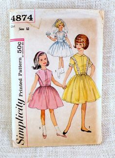 Simplicity 4874; ca. 1963; Girls One-Piece Dress: Dress has high round neckline, bodice back button closing, plastron and gathered skirt with concealed back opening. Plastron has box pleat at center front. V. 1 and 2 have Peter-Pan collar and short set-in sleeves. V. 1 has lace insertion and lace edging trim and a ribbon sash. V. 2 has organdy medallion trim and a self fabric bow. V. 3 is collarless and sleeveless, has rick rack trim and a self fabric or purchased belt.  Pattern is complete…